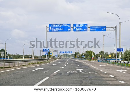 Multilane highway car c pointers towns over it