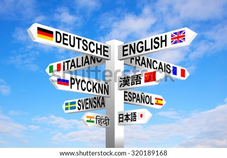 Multilingual languages and flags sign post against blue sky  - stock photo