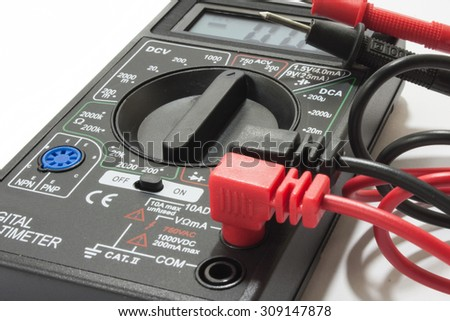 Multimeter instrument with wires on the white background. - stock photo