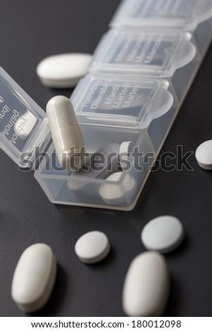 multinlingual pill box - stock photo