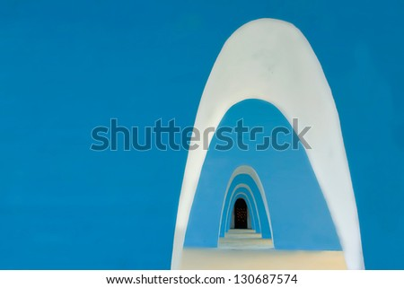 Multiple Arch Walls with Lit Candles In Background. - stock photo