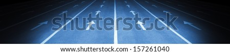 Multiple arrows and lane markings - stock photo