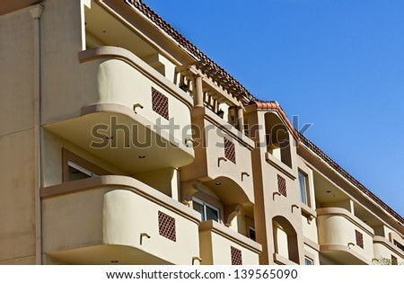 Multiple balconies on a residential building. - stock photo