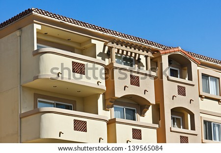 Multiple balconies on a residential structure. - stock photo