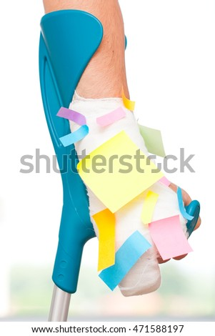Multiple blank sticky notes on a bandaged hand.