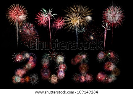 Multiple bursts of colorful fireworks were used to write out the new year 2013 with additional explosions above against a black background - stock photo