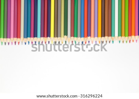 Multiple color wooden pencils on white background - stock photo