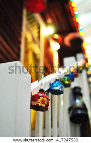 Multiple colorful tea lamps decorated on a Malay village house during Muslim Celebration  - stock photo