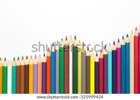 Multiple colours of wooden pencils on white background - stock photo