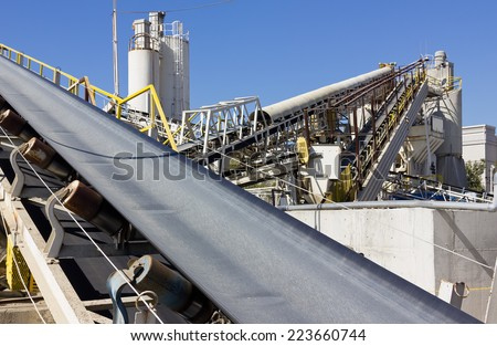 Multiple conveyor belts are used at a processing site. - stock photo