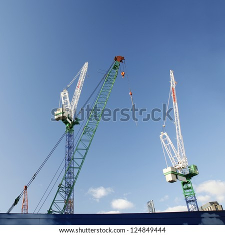 multiple cranes working on huge construction site