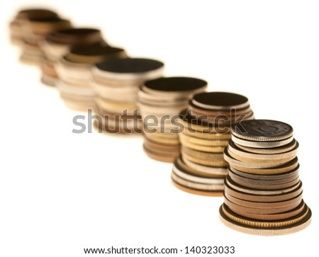 Multiple currency piles of old coins from lots of Countries isolated on a white background