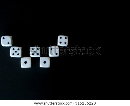 Multiple dice in the form of the letter 'W' for winner - stock photo