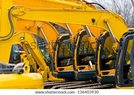 Multiple Excavator Cabs all in a row on Construction Equipment - stock photo