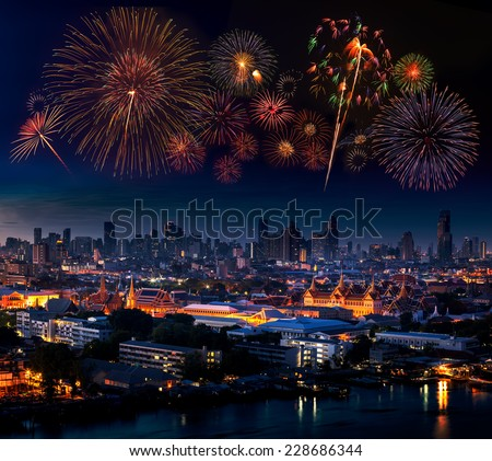 Multiple fireworks exploding high in the sky over Grand Palace, Bangkok, Thailand - stock photo