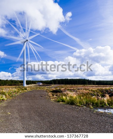 Multiple frame exposure of a wind turbine in Scotland - stock photo