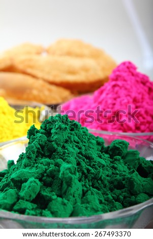 multiple holi colors with gujiya at background - stock photo