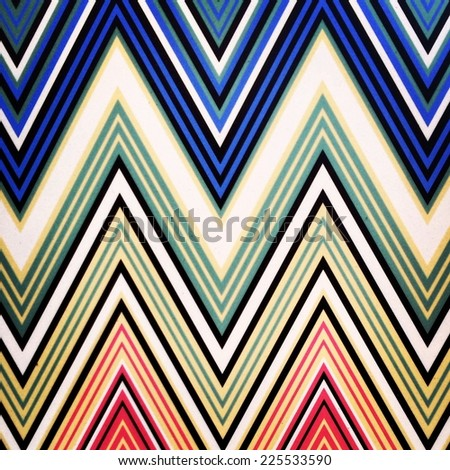 Multiple lines painted on a wall in an abstract pattern. - stock photo