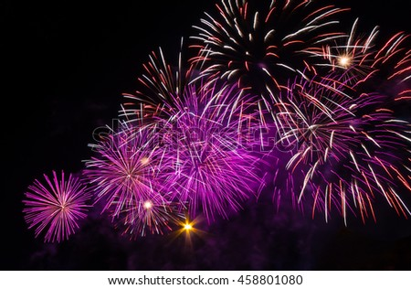 Multiple magenta pink isolated fireworks burst - stock photo