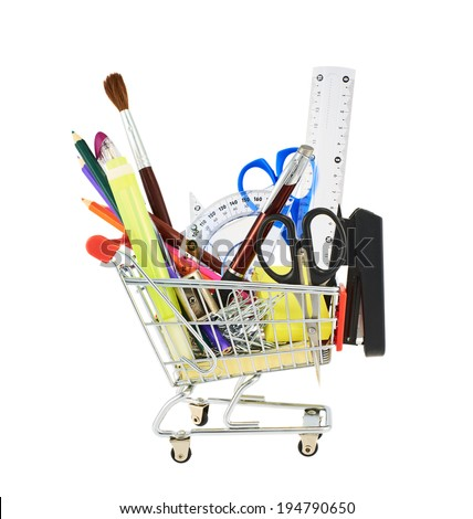 Multiple office tools in a shopping cart, isolated over the white background - stock photo
