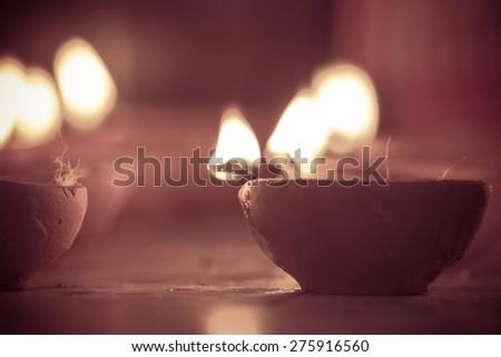 multiple oil lamps lit on diwali festival - stock photo
