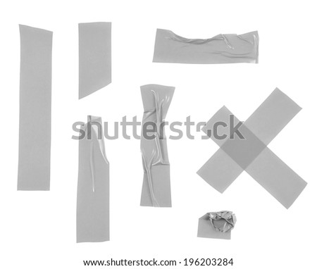 Multiple pieces of gray insulating tape of different shapes, isolated over the white background - stock photo