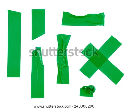 Multiple pieces of green insulating tape of different shapes, isolated over the white background - stock photo