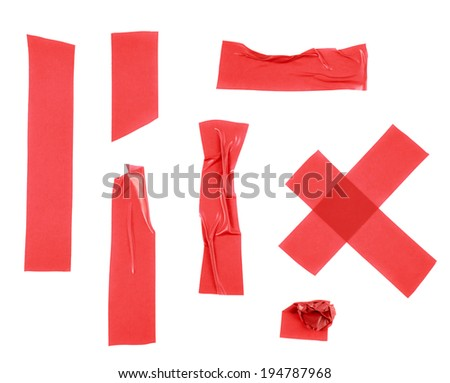 Multiple pieces of red insulating tape of different shapes, isolated over the white background - stock photo