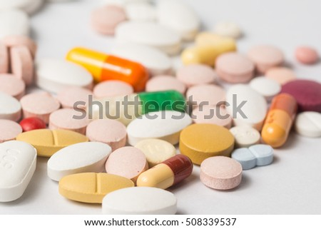 Multiple pills depicting medical treatment or pahrmaceutical industry. High resolution image.
