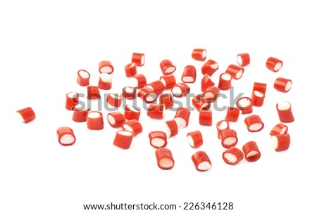 Multiple red and white candy sweets spilled over the white surface, composition isolated over the white background - stock photo