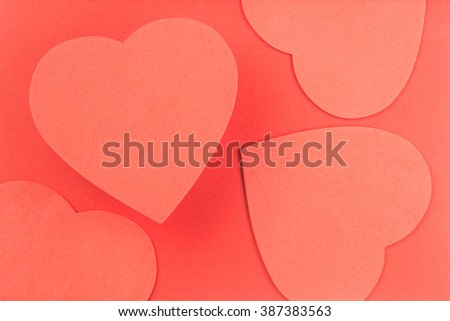Multiple red hearts on red background