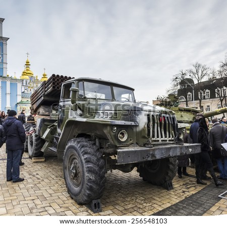 "Multiple rocket launchers ""BM-21 Grad"" against the background of Michael's Monastery. Exhibition of Russian weapons, brought from the combat zone in the Ukraine. Kiev, February, 2015"