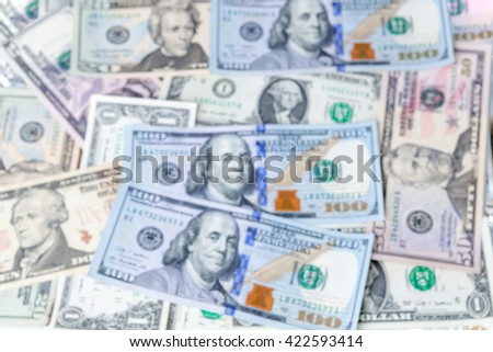 Multiple scattered American hundred dollar banknotes in full frame coverage with corner vignetting viewed from above in a conceptual financial background - stock photo