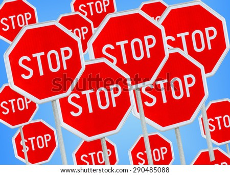 Multiple stop sign against blue background  - stock photo