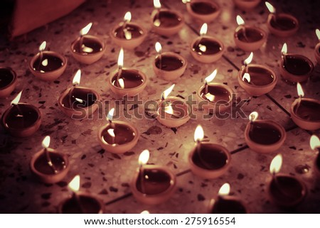 multiple traditional oil lamp, diwali celebration - stock photo