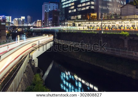 Multiple train lines coverage at Ochanomizu Station, Tokyo, Japan, at night.