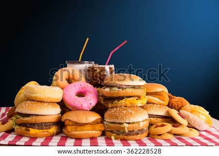 Multiple type of Fast food on table. - stock photo