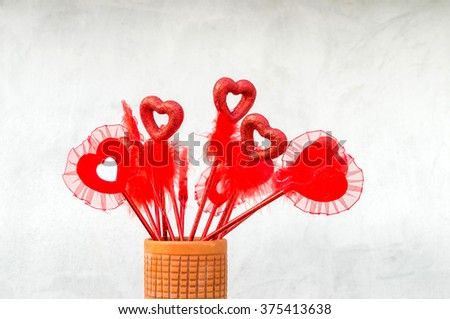 Multiple Valentine love symbol in vase isolated in white background - stock photo