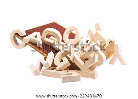 Multiple wooden letters in a book shaped casket, composition isolated over the white background - stock photo