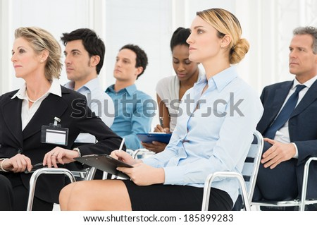 Multiracial Businesspeople Attending A Seminar Together