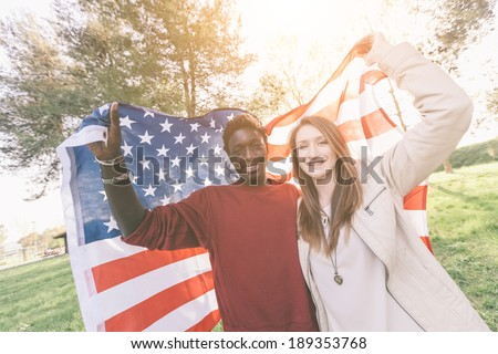 Multiracial Couple Holding American Flag - stock photo