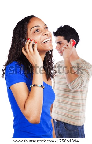 Multiracial couple holding cellphones isolated on white - stock photo