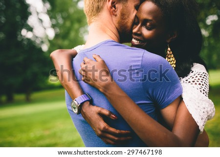 Multiracial couple in the park - stock photo