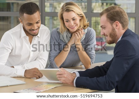Multiracial couple with a  real estate agent