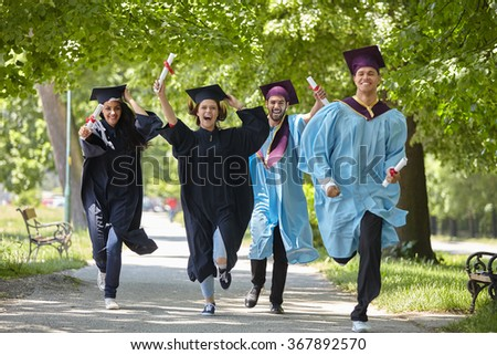 multiracial graduates - stock photo