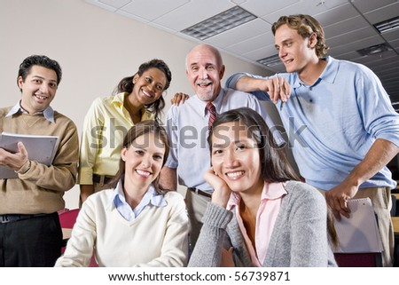 Multiracial group of college students and teacher in class