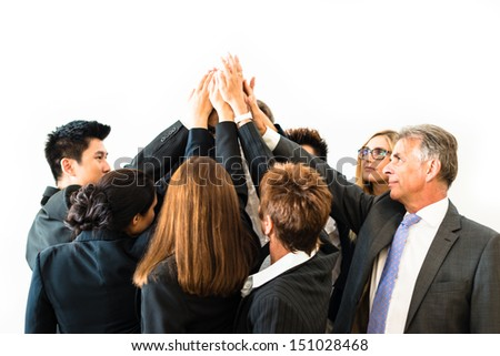 Multiracial group of eight diverse businesspeople standing in a circle facing each other joining hands in a team - white background with space for your copytext - stock photo