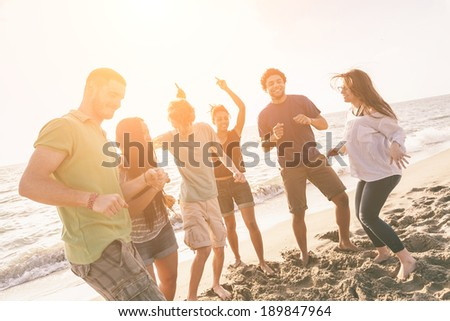 Multiracial Group of Friends Having a Party at Beach - stock photo
