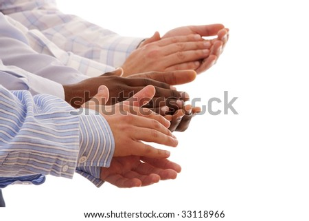 multiracial hands clapping together isolated on white (selective focus) - stock photo