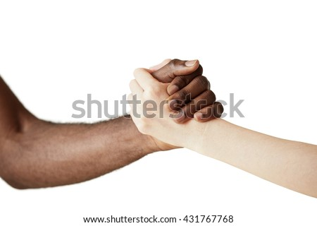 Multiracial handshake between black African man and white Caucasian woman. Two people holding hands in respect and solidarity against white wall background. Interracial friendship and cooperation - stock photo